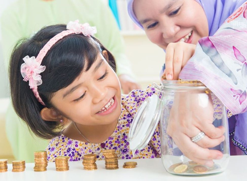 two girls counting coins from a jar