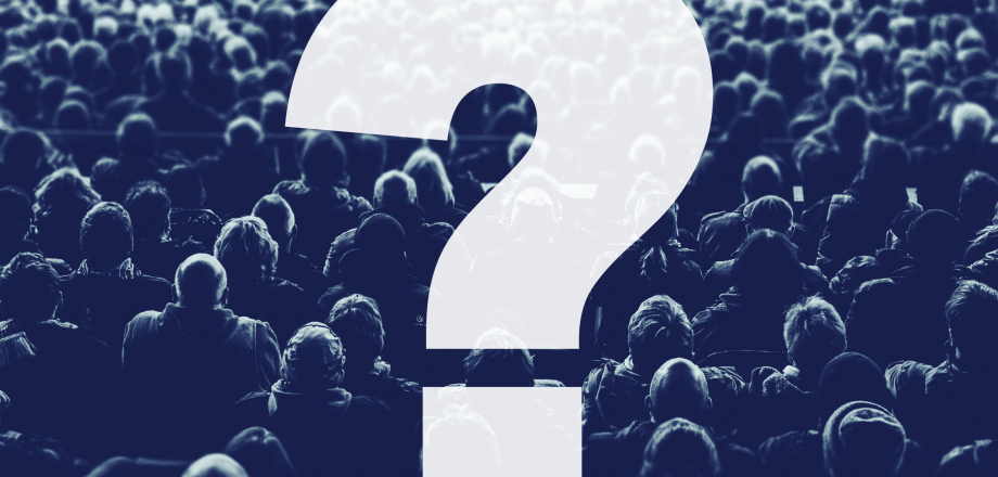 A question mark superimposed over a crowd of people