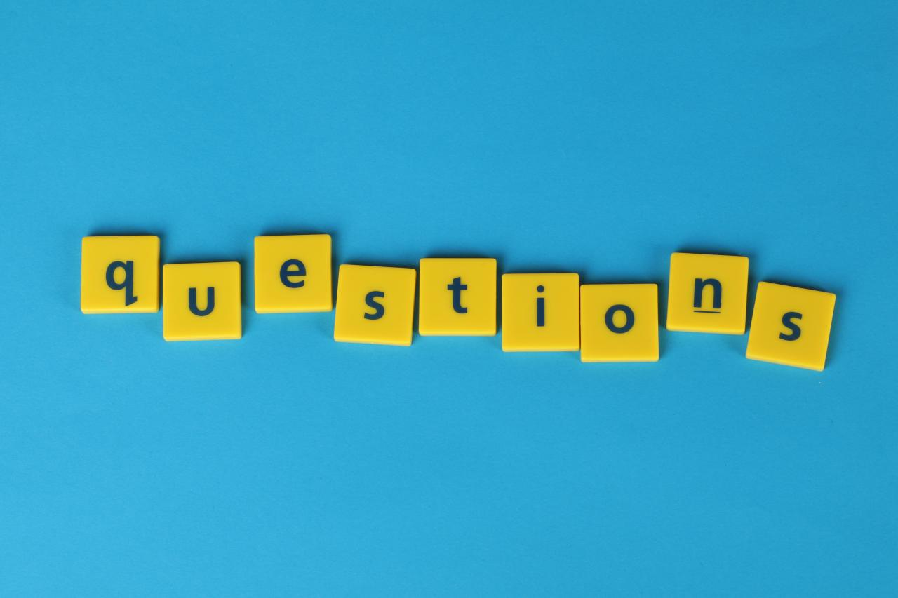 """The word """"questions"""" spelled out in letter tiles"""