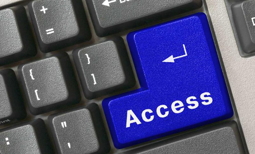 """Zoomed in view of the word """"access"""" on a keyboard return key."""