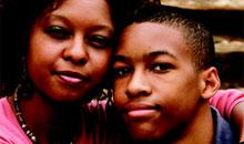 Photograph of a smiling mother with her teen son