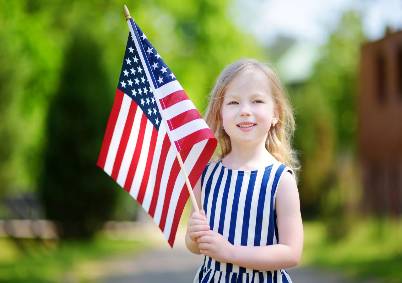 young girl holding U.S. flag