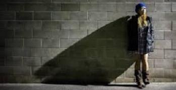 Single female standing near wall