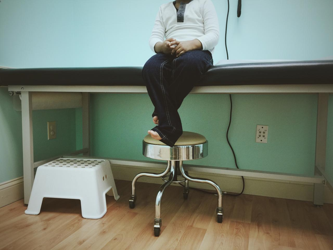 Patient sitting in a doctor's exam room