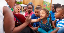 Head Start teacher reading to children